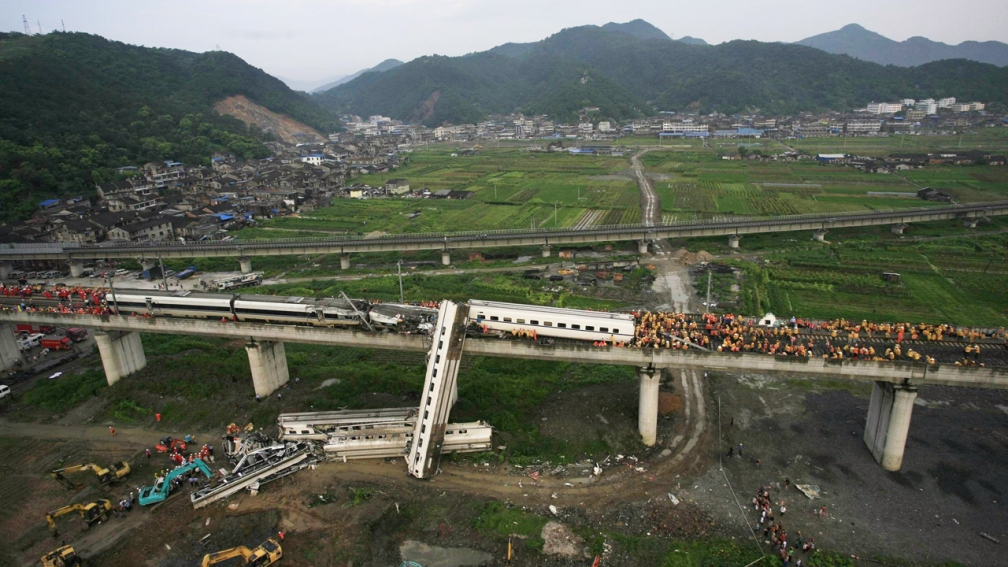 Image: An aerial view of rescuers working around the accident site where two trains had collided on a bridge on July 24, 2011 in Wenzhou, Zhejiang Province of China